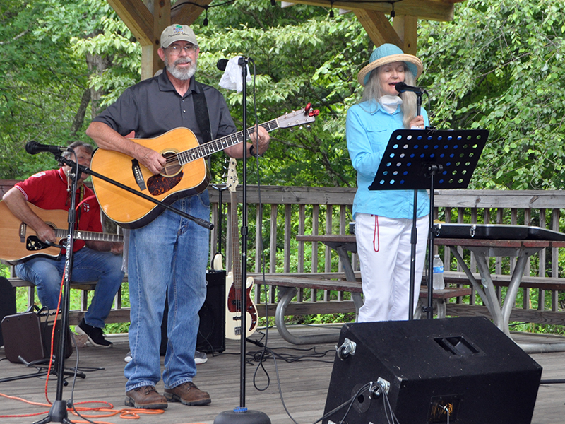 Jim and Marci Wilcox were among the performers during Pickin' in the Park at Ron Henry Horseshoe Bend Park Thursday, July 9. Pickin' returned to the park after being absent for almost ten months, and now continues back on schedule starting at 6 p.m. every Thursday.