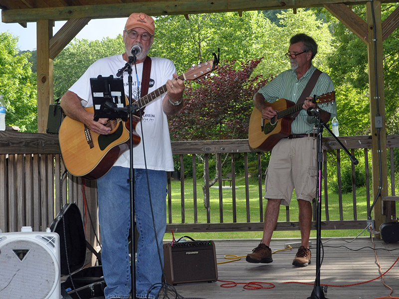 Dan Adams sings and plays his guitar during Pickin' in the Park, Thursday, June 9.