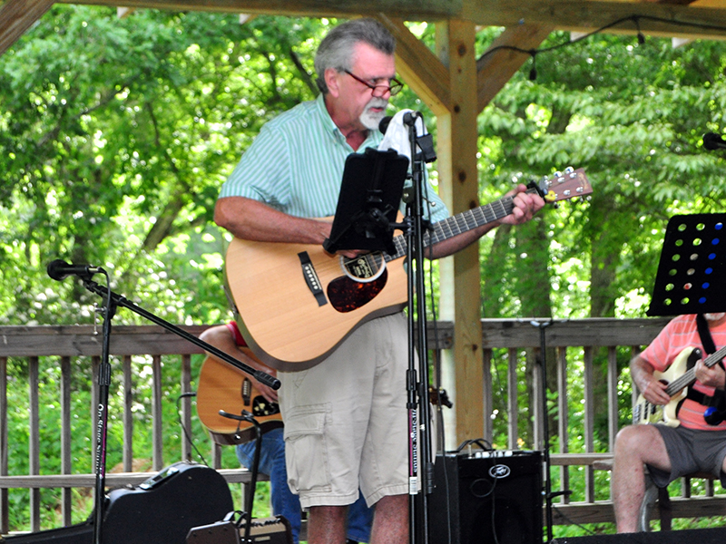 Singer and guitarist Phil Lee takes center stage during Pickin' in the Park at Ron Henry Horseshoe Bend Park Thursady, July 9.
