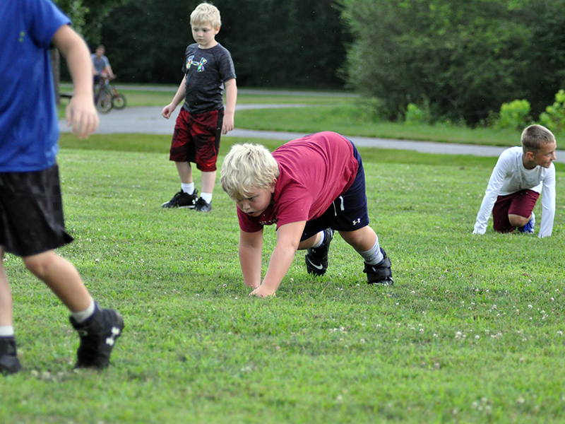 Zion Wood bear crawls to get warmed up at the start of Fannin's six and seven year old football practice Tuesday, July 21.