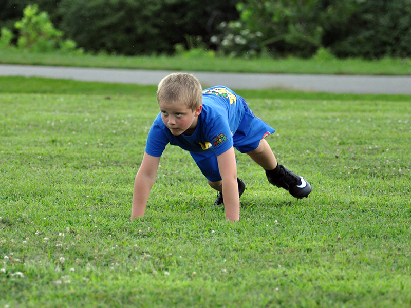 Jonah Johnson focuses on the coach during Fannin's rec league football practice Tuesday, July 21.