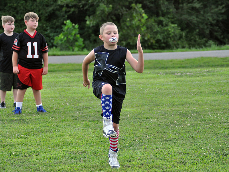 Kylan Geller limbers up during warm-ups at the Fannin County Recreation Center football practice Tuesday, July 21.