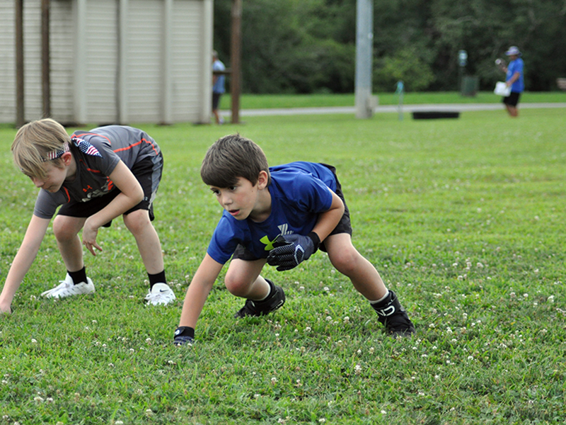 Kyle Allen works on his three-point stance during football practice at the Fannin Recreation Center Tuesday, July 21.