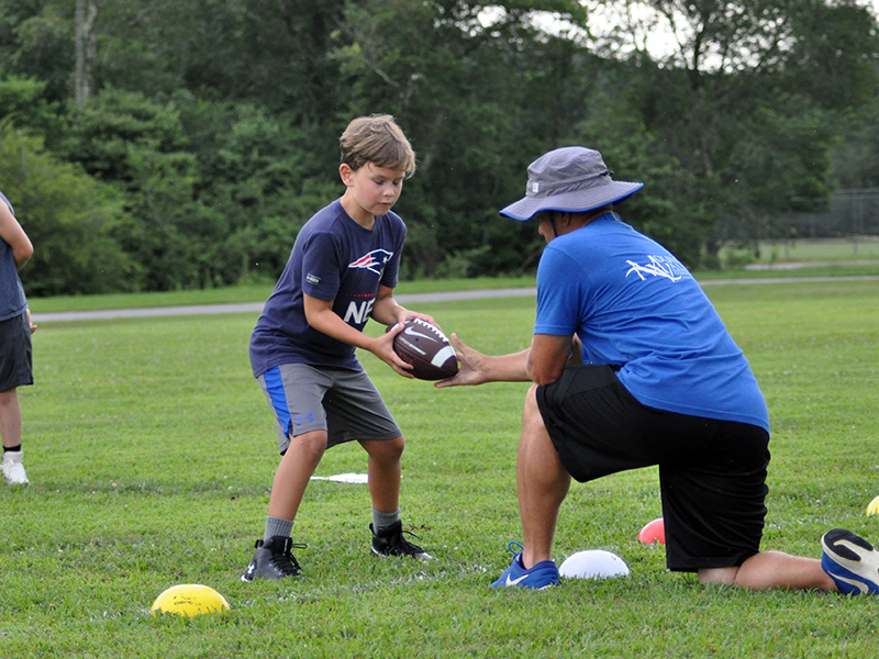 Braxson Newton practices at the quarterback position during football practice Tuesday, July 21.