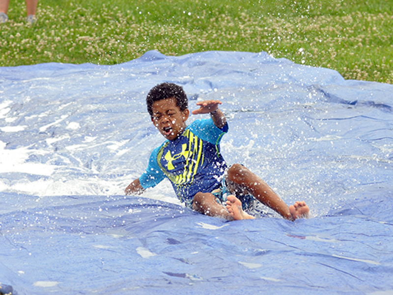 Jamari Dunn enjoys the slip-n-slide during water day at the Fannin Recreation Center's  summer camp, Wednesday, July 8.