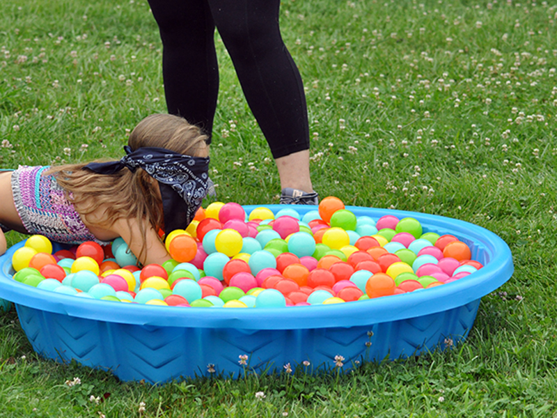 Payton Deal searches for a prize in a small pool during the Fannin Recreation Center's summer camp, Wednesday, July 8.