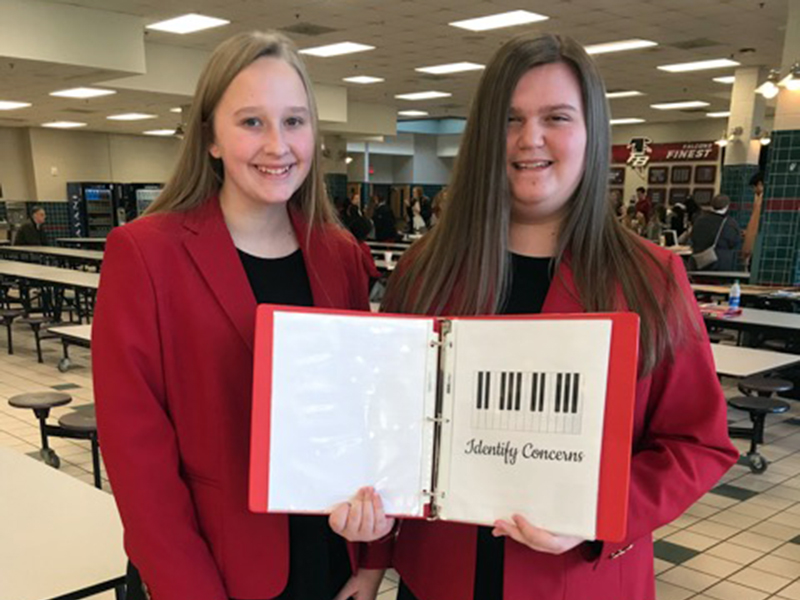 Fannin County High School Family Career and Community Leaders of America (FCCLA) members Anna Rhodes, left, and Gracie Stewart presented their Chapter Service Project Portfolio Level 2 project at this year's national competiton, where they received first place in the nation.