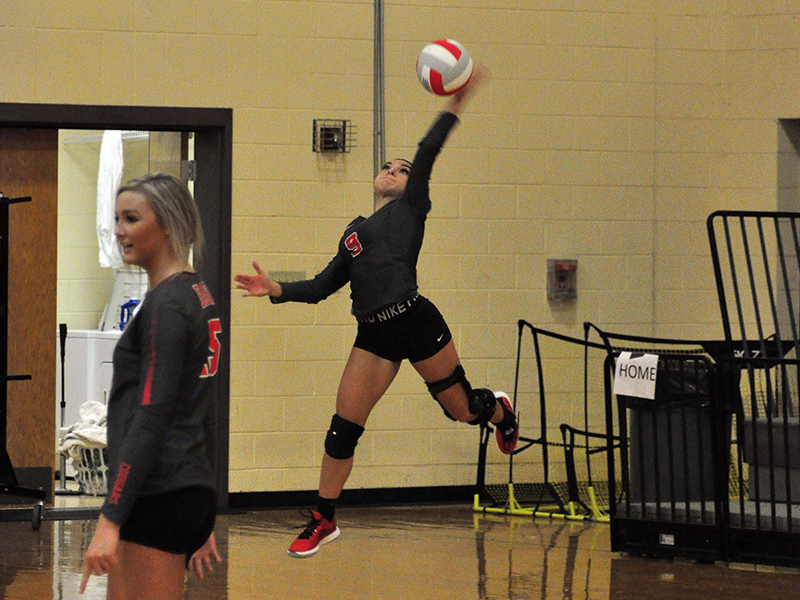 Lady Cougar Sydney Hickey serves the ball in recent action for the Copper Basin Lady Cougars volleyball team.