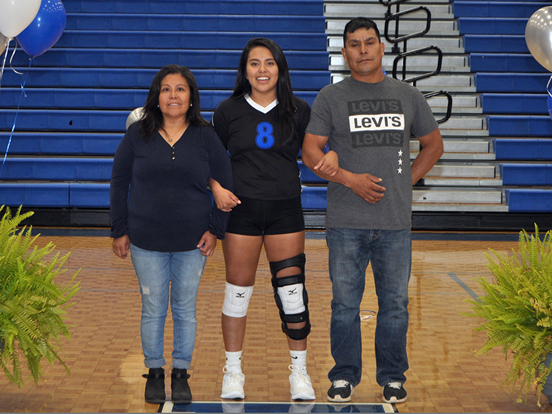 Prisila Bautista was one of five seniors honored during the Lady Rebels volleyball team senior night Thursday, September 10. She is shown with her parents Elvia and Victor Bautista.