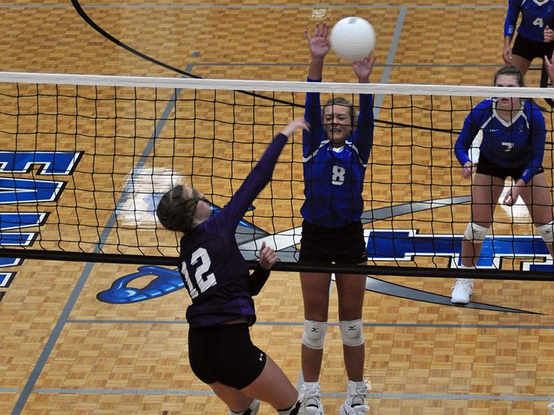 Reagan York attempts to block a spiked ball in recent action for the Lady Rebels volleyball team.