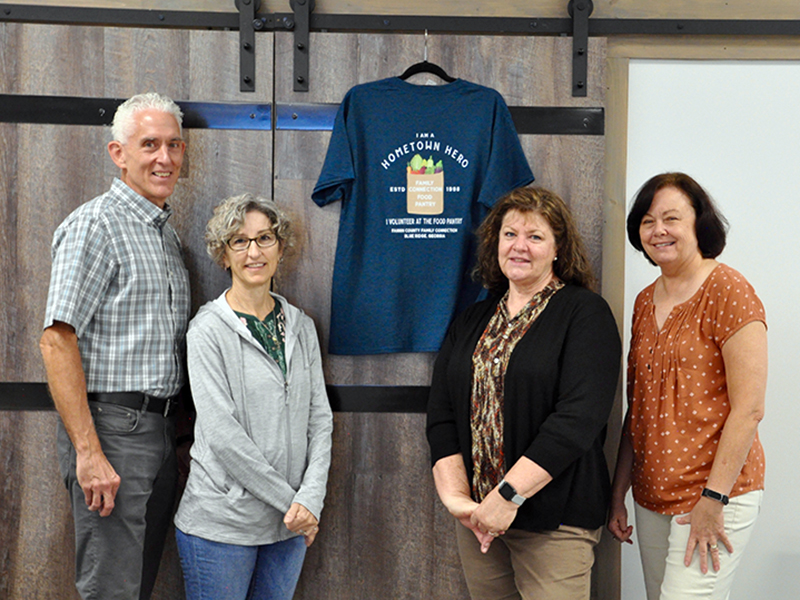 Fannin County Family Connection volunteers were treated to a large lunch and were gifted T-shirts Friday, September 25. Shown next to a shirt is, from left, Tom and Nancy Niswander, Priscilla McDonald and Kathy Jones.