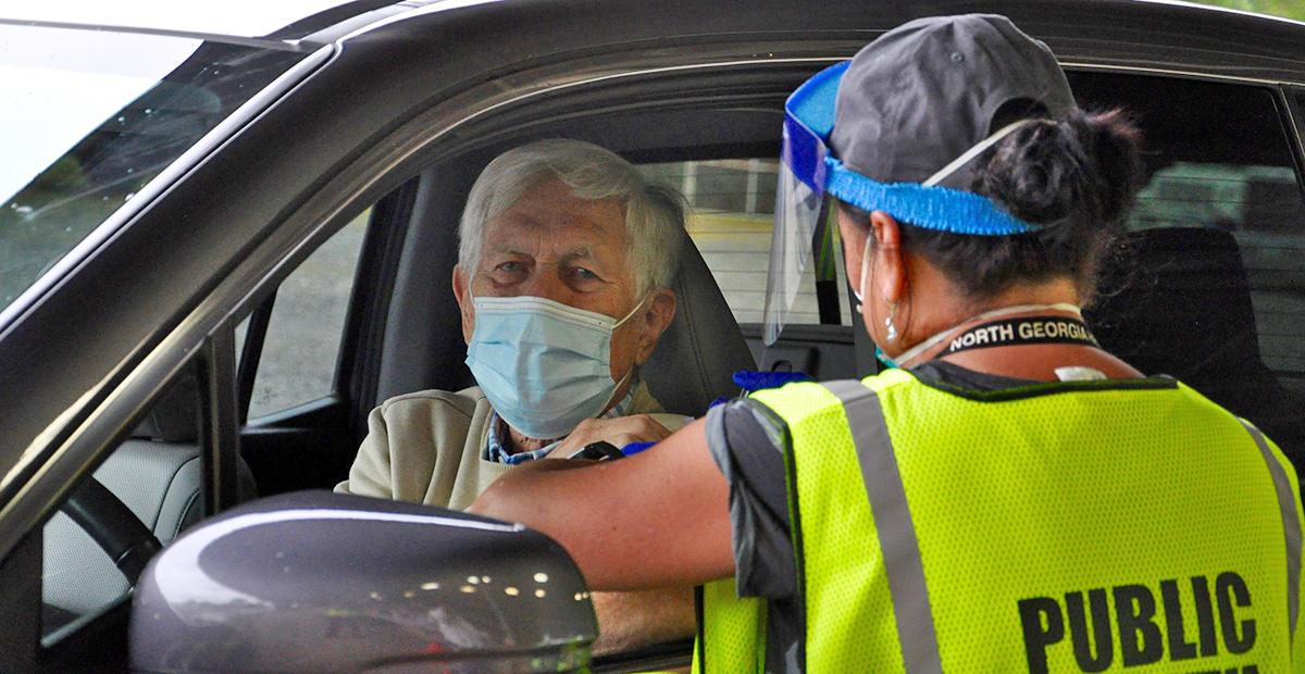 Fannin County Health Department held its annual Drive-Thru Flu Shot Clinic Thursday, September 24, which saw a large turn out. Shown getting a vaccine is Scott Macneill and administering the shot is county Nurse Manager Hollye Petty.