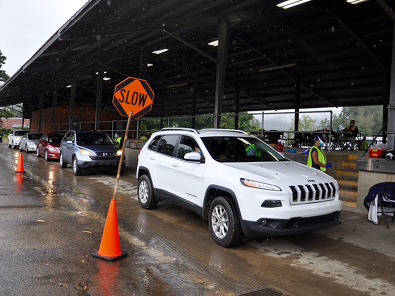 The rain couldn't stop the parade that was a seemingless endless line of cars filled with drivers and passengers waiting to get a flu vaccine during the Fannin County Health Department's annual Drive-Thru Flu Shot Clinic.