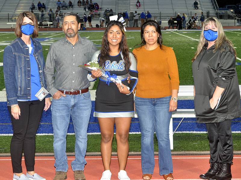 Fannin County High School honored six cheerleading seniors on senior night Friday, October 9. Shown are, from left, father, Ruben Rosas, Rosas and mother, Josefina Rosas.