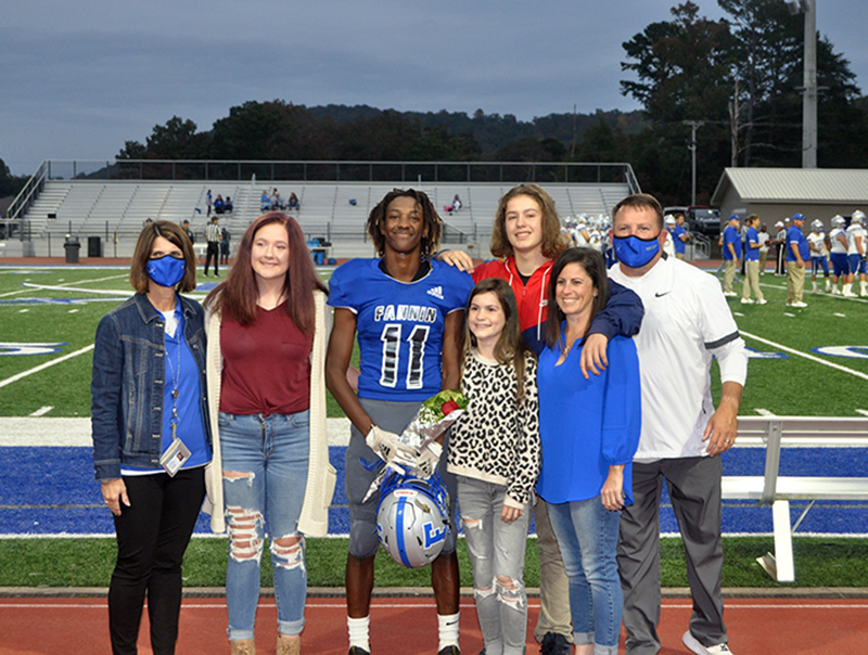 Andre Bivens was one of 15 seniors honored before the Rebels football game against Gordon Central Friday, October 9. Shown are, from left, Ivy Hyde, Bivens, Danica Padrut, Chaz Padrut, Joci Padrut and coach Chad Cheatham.