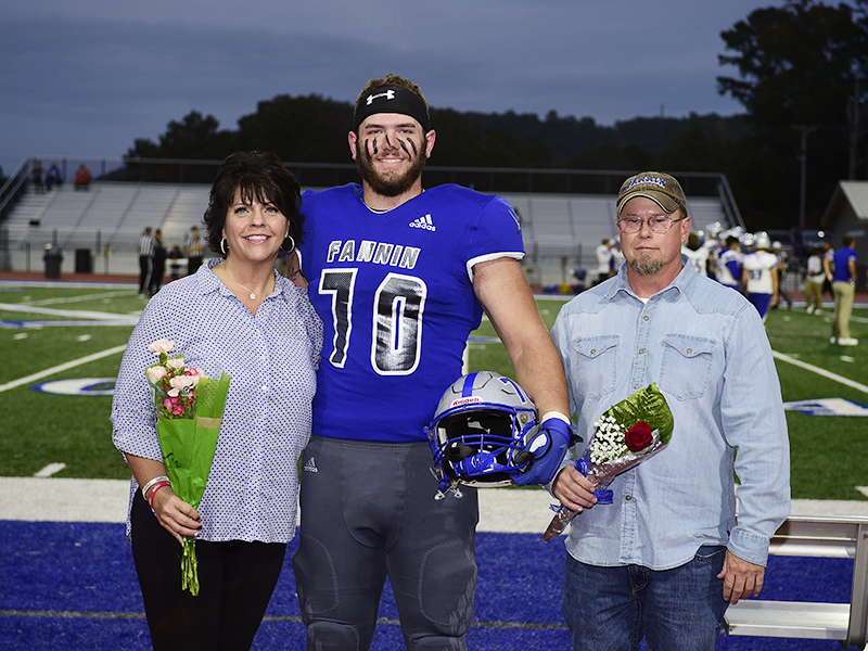 Mason Bundy was one of 15 football seniors to be honored during Fannin County's senior night, before the game against Gordon Central Friday, October 9. Bundy is shown with his mother, Dena Johnson, and stepfather, Chris Johnson.
