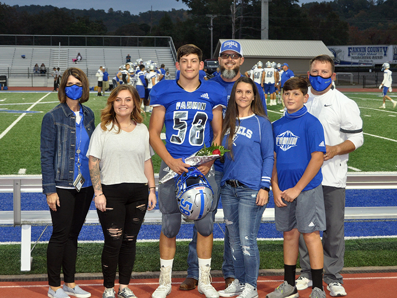 Fannin County High School honored the senior football, cheerleaders, band, cross county and sports medicine members before the Rebels game with Gordon Central Friday, October 9. Shown are, from left, sister, Chelsea Quintrell, senior, Bradyen Foster, father, Micah Foster, mother, Charlene Foster, brother, Vince Foster and coach Chad Cheatham.
