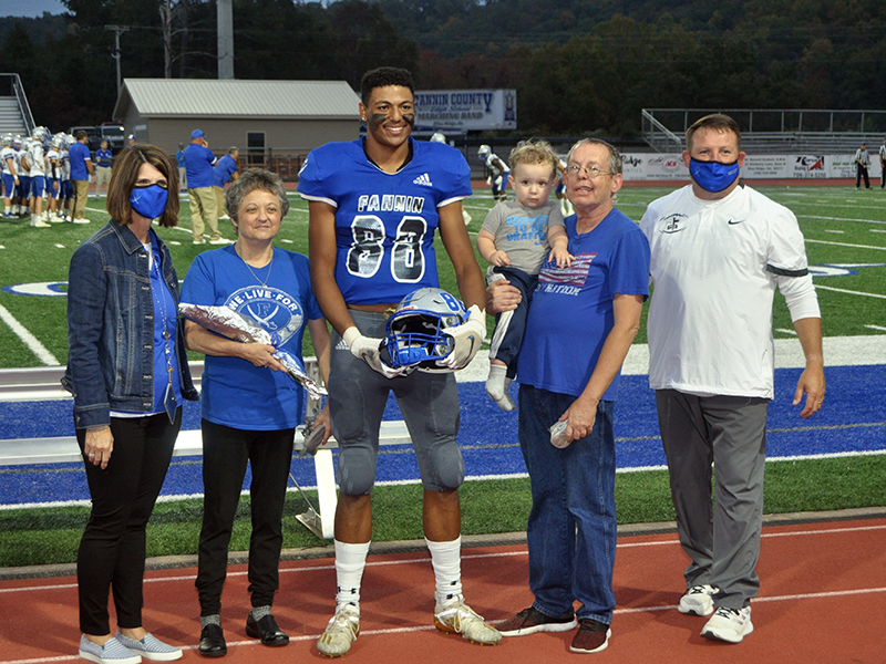 Jaylin Ingram was one of 15 football seniors honored during senior night at Fannin County High School Friday, October 9. Ingram is shown with Rhonda and Jeff Ingram.