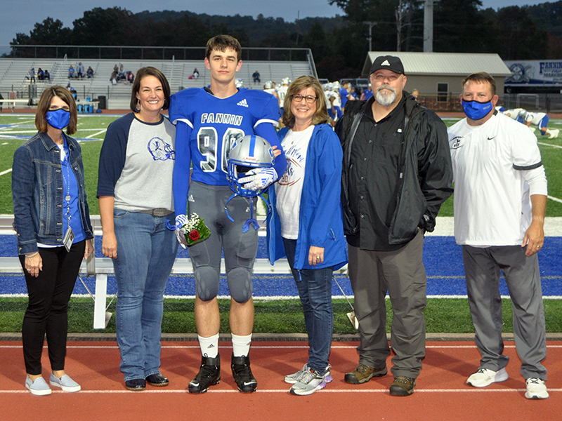 Fannin County senior Tommy Ledford was recognized with 15 other football seniors during the Rebels senior night ceremony Friday, October 9. Shown are, from left, Bridgette Butynski, Ledford, mother, Trish Ledford and father, Keith Ledford.