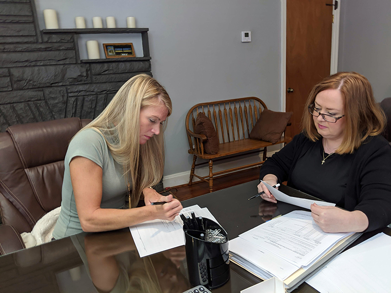 Habitat for Humanity of Fannin and Gilmer counties' most recent home build recipient Kristen Haley, left, officially became a homeowner Saturday, September 30. She is shown beside Attorney Laura J. Ray.