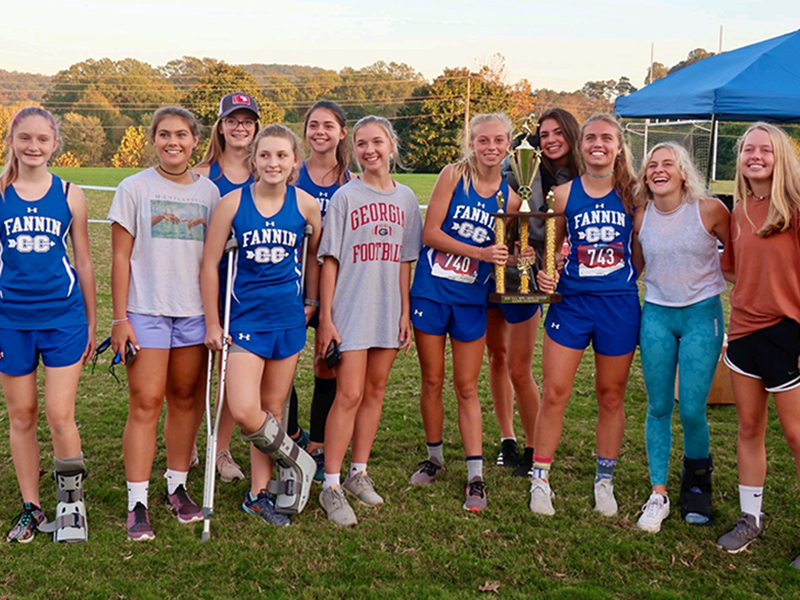 The Fannin County Lady Rebels cross country team won first place in the region at thier region meet Tuesday, October 27. Shown following the region victory are, from left, Erin Jones, Taylor Poland, Olivia Temples, Shaylee Jones, Kristin Cipich, Hannah Sosebee, Carlee Holloway, Monica Cosentino, Kinsley Sullivan, Teagan Cioffi, Annabell Lillard.