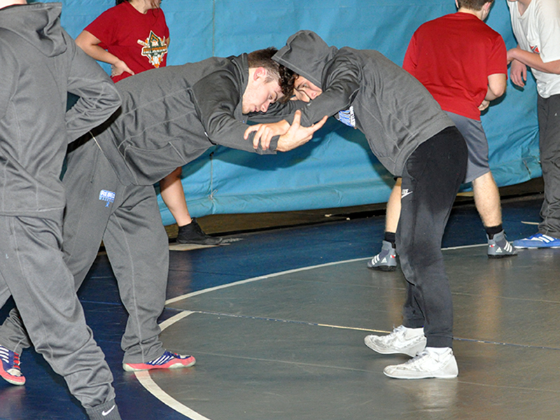 Caleb McTaggart, left, and Zechariah Prater wait to attack during the Rebels wrestling practice  Wednesday, December 16.
