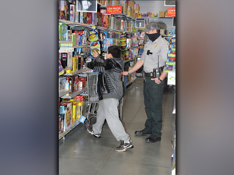 Choosing a Christmas gift isn't always easy for youngsters taking part in Shop With A Cop. This young man was helped Saturday by Department of Natural Resources Sergeant Cody Long.