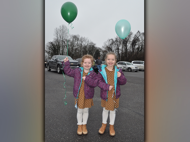 Arlie Reese Mayfield, left, and Kennedy Lynn smile with thier balloons as they wait for the balloon release to begin. The event was to celebrate the life of Sydnie Jones.