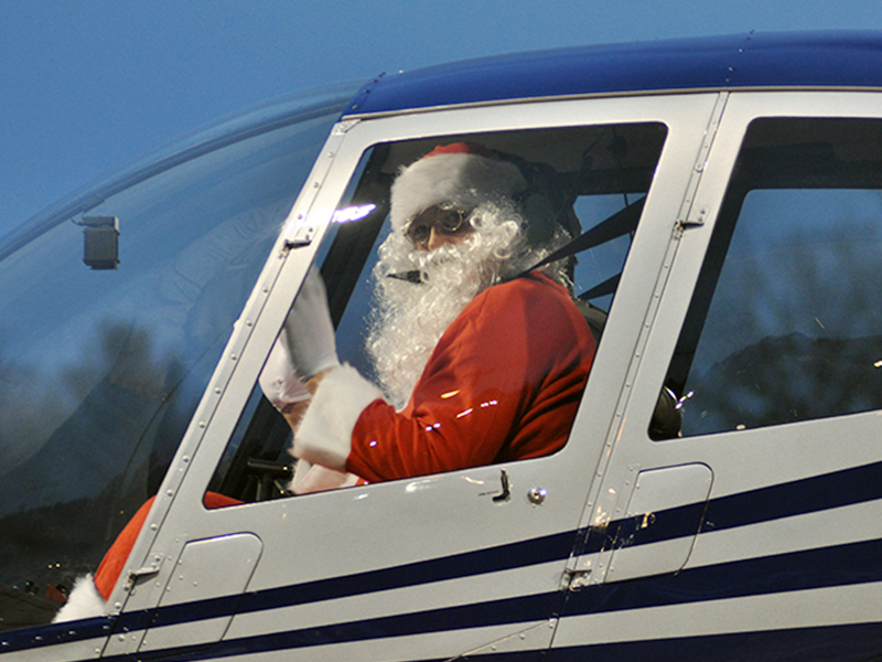 Santa Claus waves from the helicopter as he and pilot Damon Williams land at the Fannin County Recreation Department Wednesday, December 23. Santa made his appearance during a special drive-thru event. Due to COVID-19 restrictions, he wasn't able to visit personally with children, but his appearance brightened many faces.