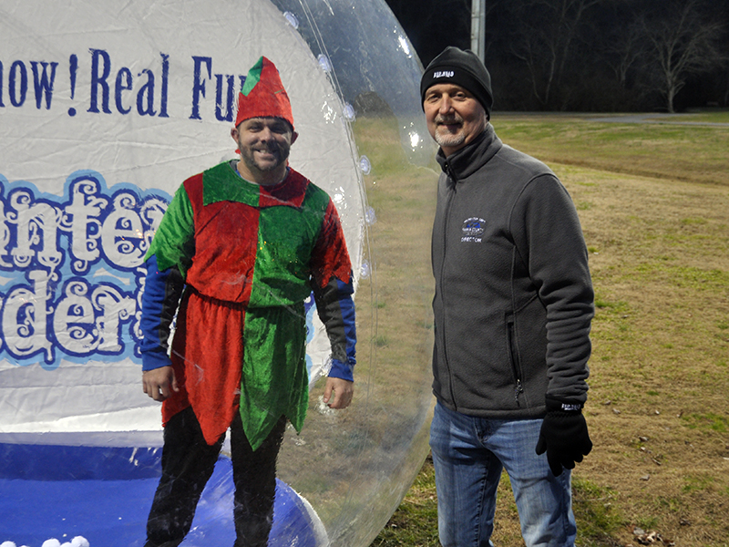 Santa's helper Tim Towe took up his duties in a snow globe next to Fannin Recreation Department Director Eddie O'Neal during Santa's visit to the Fannin County Recreation Center Wednesday, December 23.