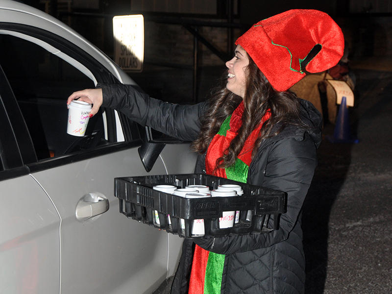 Hannah Fortenberry passed out hot chocolate to people that came to see Santa Claus at the Fannin Recreation Department.