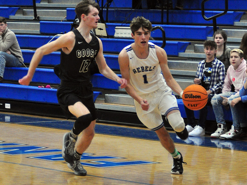 Tucker Hanson drives to the basket for two points in recent action for the Fannin Rebels.