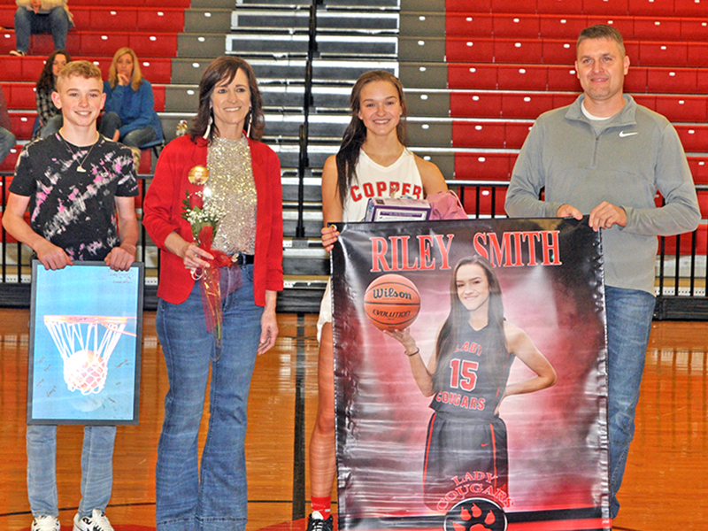 Riley Smith was one of 11 basketball and cheerleading seniors honored at Copper Basin's senior night ceremony Saturday, February 6. Shown during the ceremony are, from left, brother, Talon Smith; mother, Holly Smith; senior, Smith; and father, Kevin Smith.