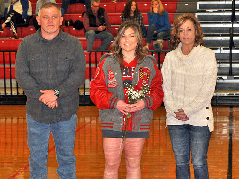 Kaitlyn Goode was one of 11 basketball and cheerleading seniors honored at Copper Basin's senior night ceremony Saturday, February 6. Goode is shown with her parents, David and Amy Goode.