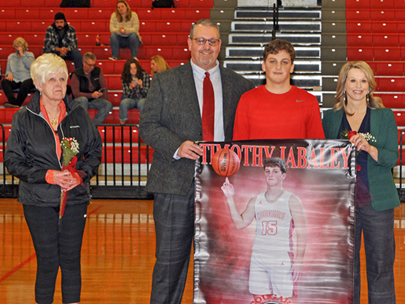 Dawson Worthy was one of 11 basketball and cheerleading seniors honored at Copper Basin's senior night ceremony Saturday, February 6. Worthy is shown with his parents Tim and Alicia  Worthy.