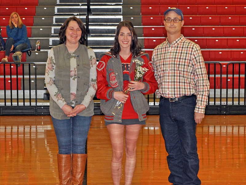Rebecca O'Neal was one of the 11 basketball and cheerleading seniors honored at Copper Basin's senior night ceremony Saturday, February 6. O'Neal is shown during the ceremony with her parents, Craig and Crystal O'Neal.
