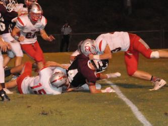 Copper Basin Cougar Chase Mickens (24) rushes to help Joe Boggs (15) and Timothy Fair (33) tackle a Tellico player during the Cougars win Friday, September 13.