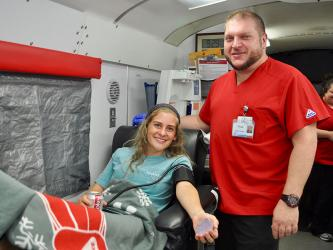 Fannin County High School student Teagan Cioffi relaxes after donating blood at Blood Assurance's blood drive on the school's campus Friday, September 20. She is shown with Donor Care Specialist Chad Taylor. The blood drive was sponsored by the high school.