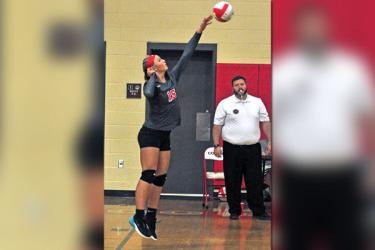 Lady Cougar Sapporiah Ross spikes the ball during Copper Basin's volleyball match with Tellico Plains Tuesday, September 3.