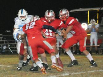 Copper Basin Cougars Larry Dye (52), Cody Montgomer (85) and Joe Boggs (15) wrap up a McMinn Central runner during Copper Basin's game against the Chargers Friday, October 11.