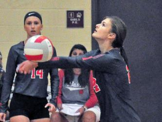 Lady Cougar Albani Dotson keeps a volley alive in recent action for the Copper Basin.