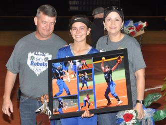 The 2019 Lady Rebel softball seniors were honored after their last home game of the season Thursday, September 26. Senior Lady Rebel Kaelyn Hensley is shown with her parents Jamie and Faith Hensley.