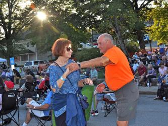 Eleanor and Mike Bliss dance the evening away to blues tunes at the Blue Ridge Blues & BBQ Festival in downtown Blue Ridge, Saturday September 21.