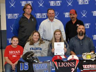 Senior Lady Rebel softball player Kayleigh Russell signed a scholarship to further her athletic and academic career at Bryan College in Dayton, Tennessee. Shown following the ceremony are, from left, front, Kelsey Russell, sister; Tina Russell, mother; Kayleigh Russell, Justin Russell, father; and back, FCHS head softball coach Alan Collis, travel ball coach Steve Young and Bryan College assistant softball coach Pete Massengale.