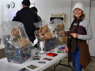 Fannin County Animal Control hosted an open house event for members of the community to come walk dogs and check out the recent improvements to the establishment Friday, November 9. Shown is volunteer Martha Jewett entering to win raffle prizes.