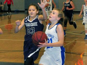 Seventh grade Lady Rebel Maddie Ledford goes up for a layup in recent action for Fannin County Middle School.