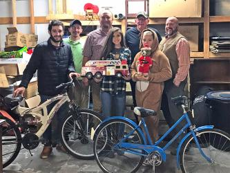 Polk County Executive Robby Hatcher and representatives of C&B Auction and Deli are shown with some of the toys donated for Polk County children. Shown are, from left, Rugby Bunch, Timothy Trulove, Tommy Bunch, Hayley Stephenson, Fred Esch, Macey Bunch and Hatcher.