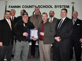 The Fannin County Board of Education recognized local law enforcement's hard work and dedication to Fannin County schools for National Law Enforcement Appreciation Day Thursday, Janaury 9. Shown are, from left, front, Assistant Superintendent Darren Danner, School Resource Officer Tracy Summers, Sherriff Dane Kirby and Superintendent Dr. Michael Gwatney; back, board members Terry Bramlett, Lewis DeWesse, Chad Galloway, Mike Cole and Bobby Bearden.