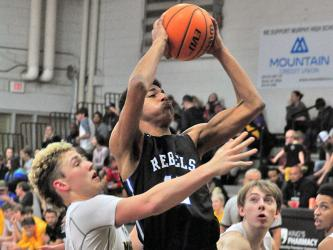Fannin Rebel Jalen Ingram fights through contact for a two-point jumper during the Rebels' win over Murphy Saturday, February 1. Ingram played a key role in bringing the Rebels back for the victory.