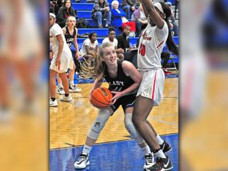 Lady Rebel Saidee Collins fights through contact in the paint for a score in recent action for Fannin County.